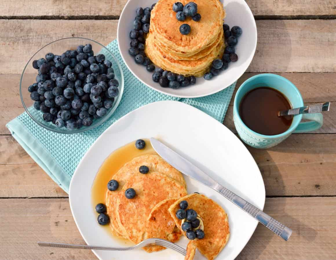 Fluffy Cottage Cheese Pancakes with maple syrup and blueberries
