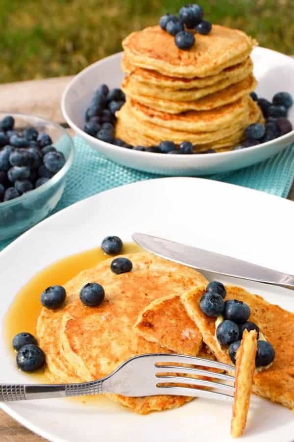 Fluffy Cottage Cheese Pancakes with stack of pancakes and blueberries