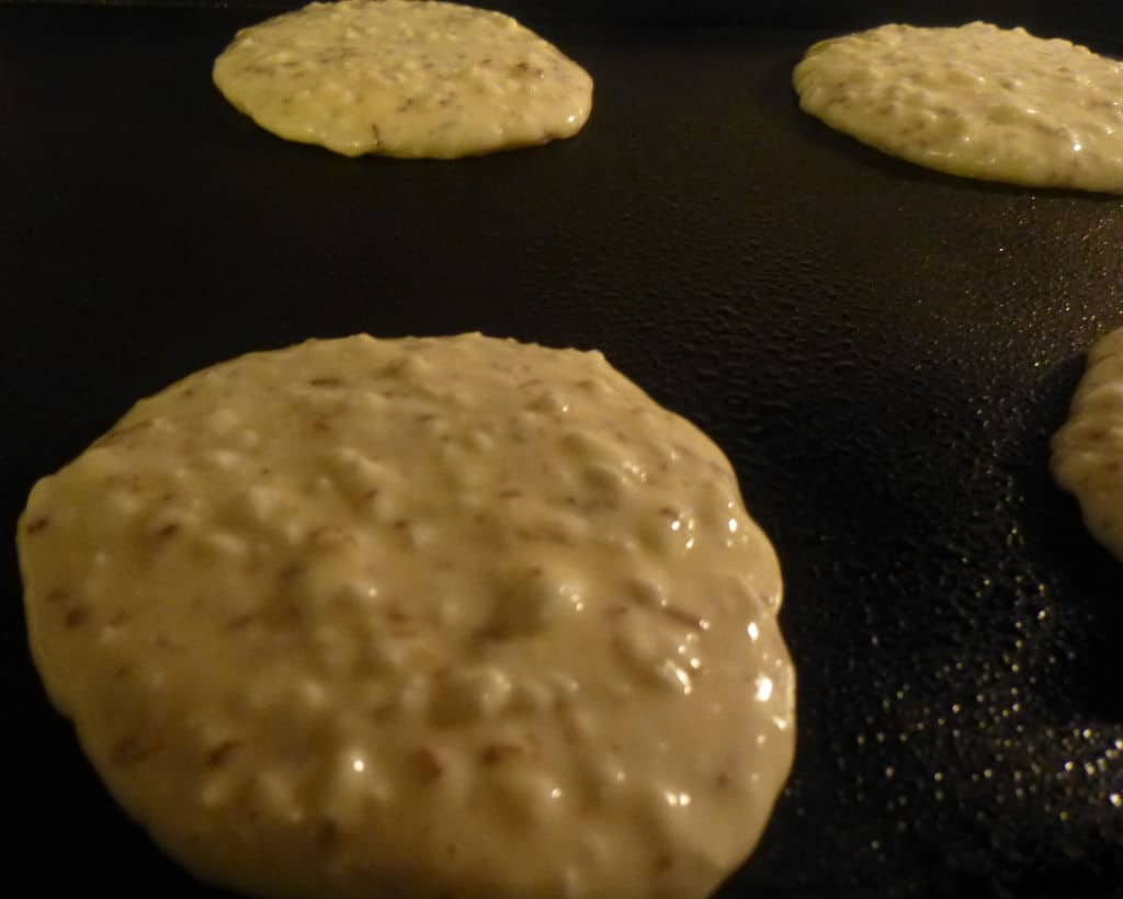 Cottage cheese pancakes cooking on the griddle
