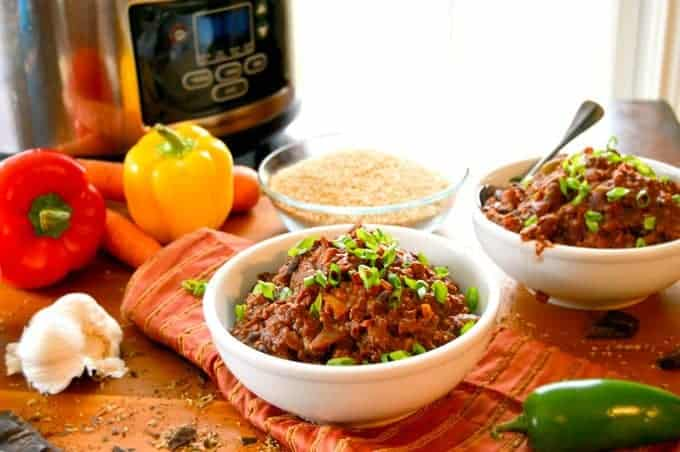 Vegetarian Chili with Quinoa & Chocolate in bowls with green onion