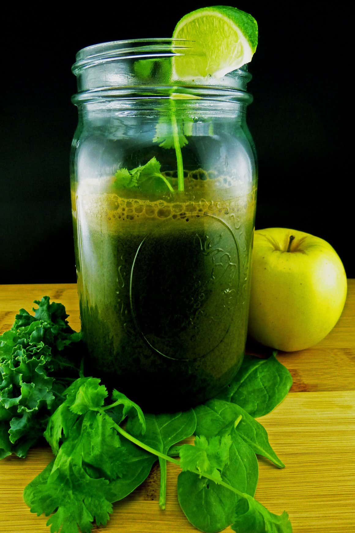 Kale Spin Kick Green Juice in mason jar with cilantro, lime and apple