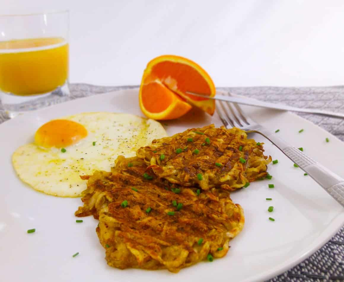 Panini Press Hash Browns plated with egg, orange and juice