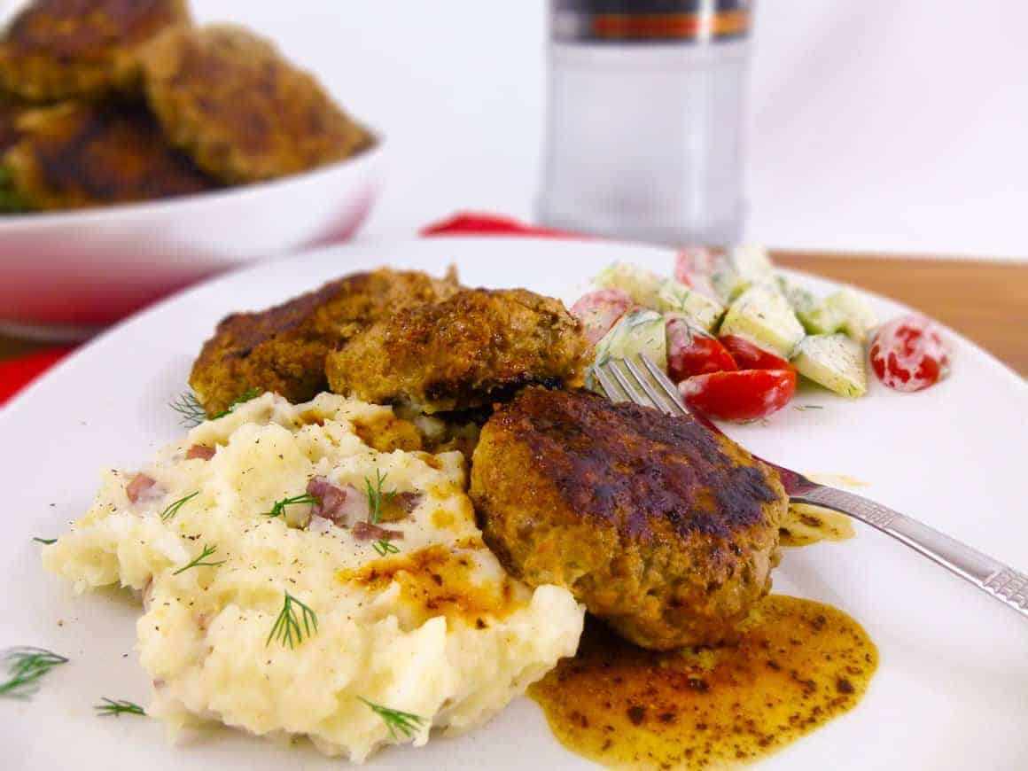Kotlety Russian Meat Patties plated with mashed potatoes and veggie salad