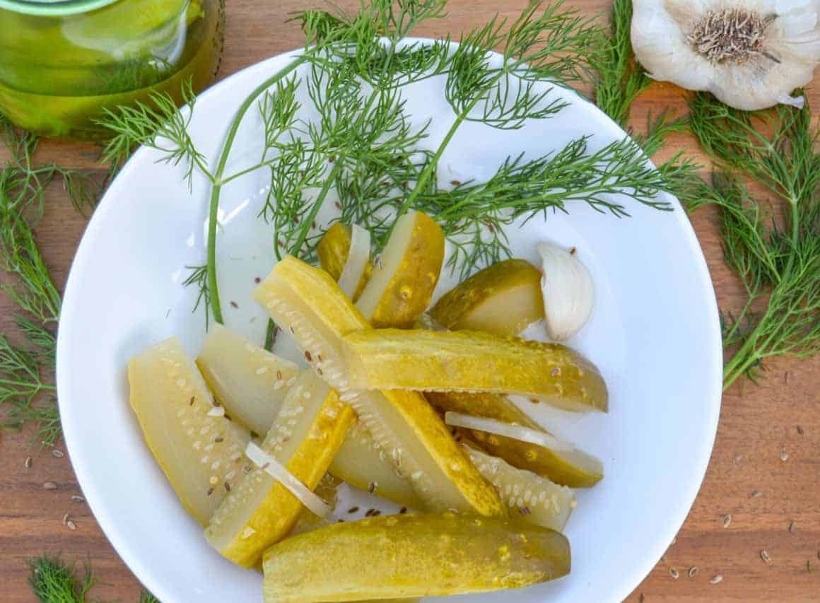 Homemade Deli Style Dill Pickles with fresh dill over top view