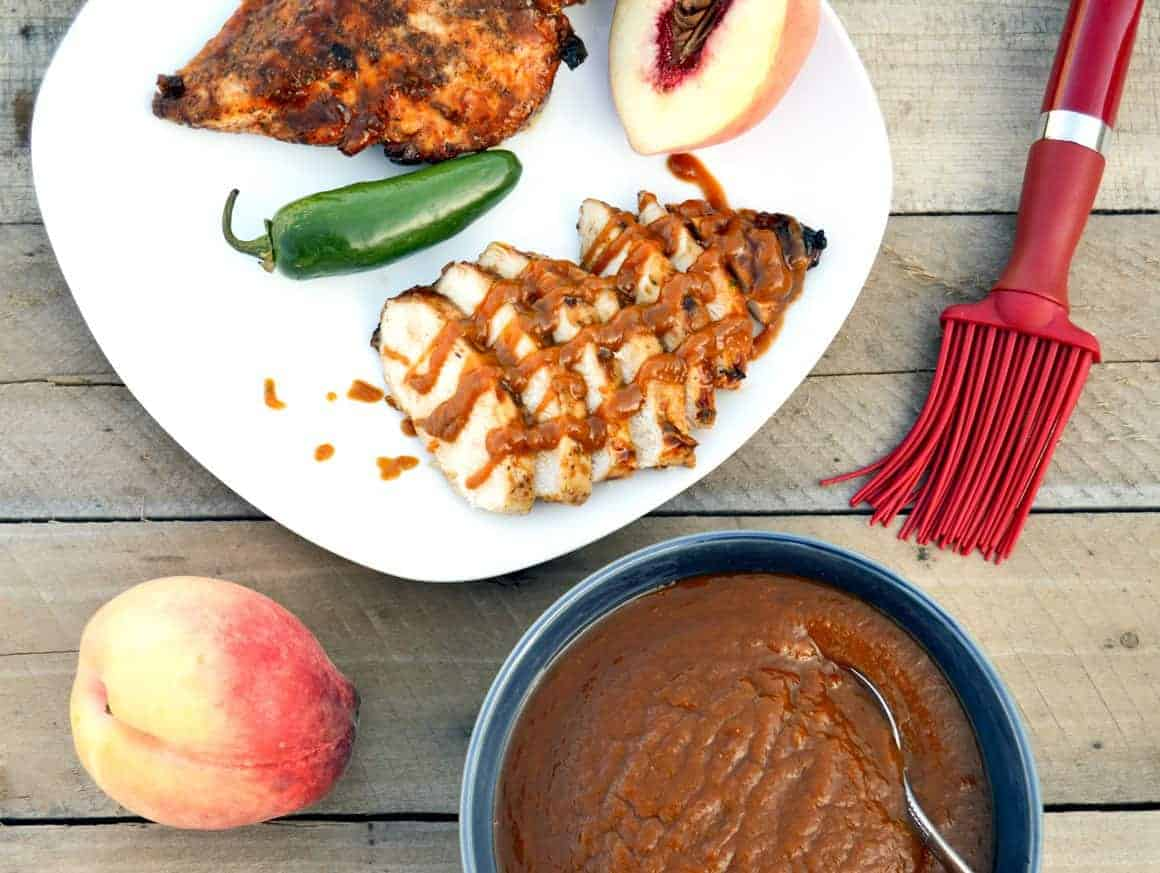 Top view Roasted Jalapeño Peach BBQ Sauce with grilled chicken