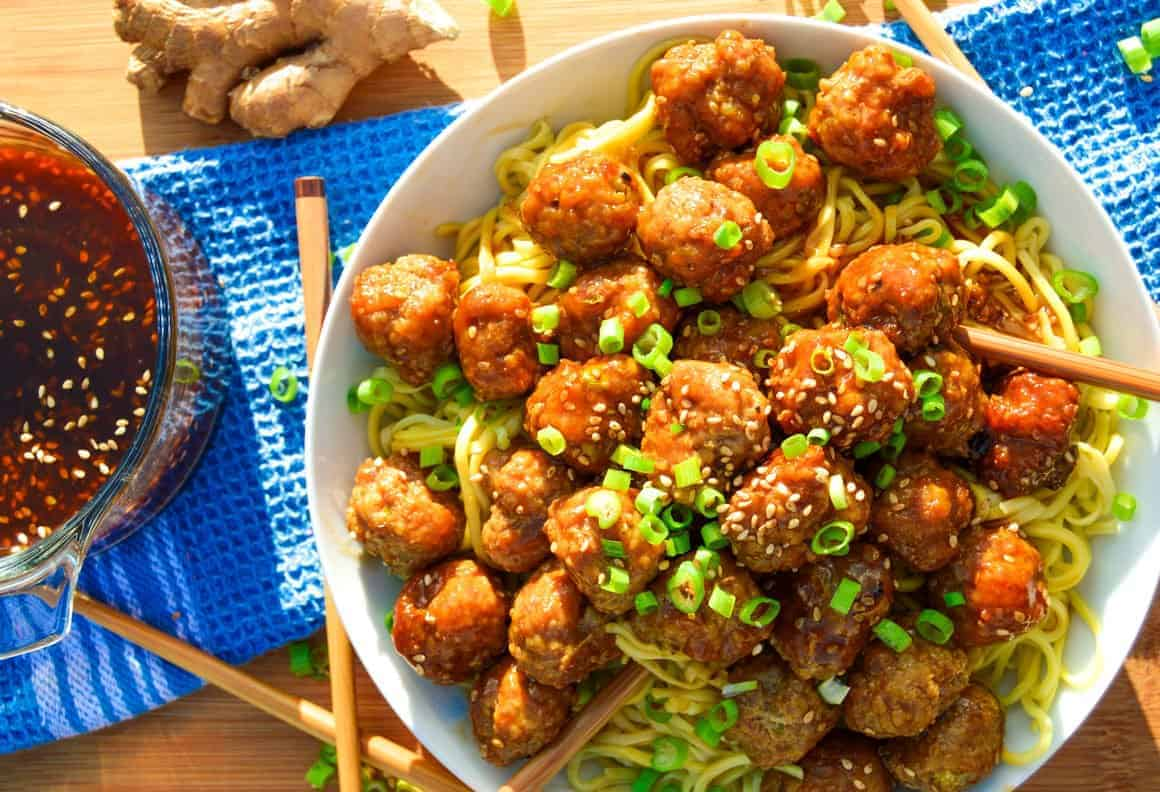 Ginger Teriyaki Meatballs close up with ginger and green onions