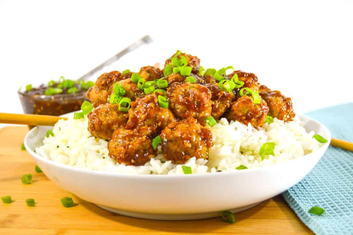 Ginger Teriyaki Meatballs on rice with green onions
