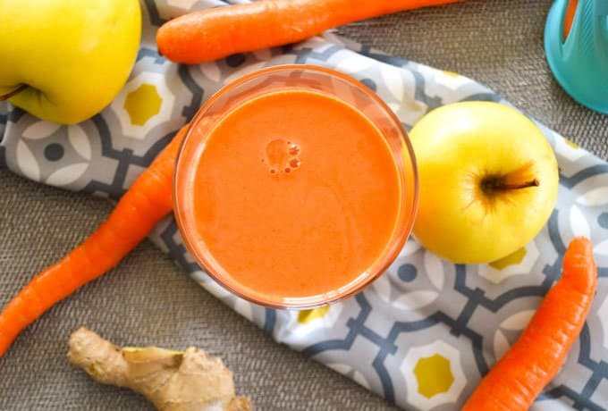 Ginger Carrot Apple Juice with apple close up