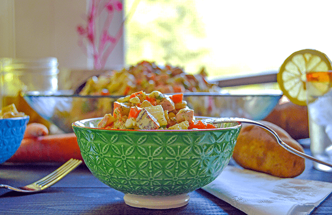Olivier Russian Potato Salad aka Salat Olivye up close in a small bowl